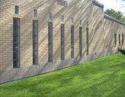 Seven candle-shaped windows at New Light Cemetery Mander Chapel building